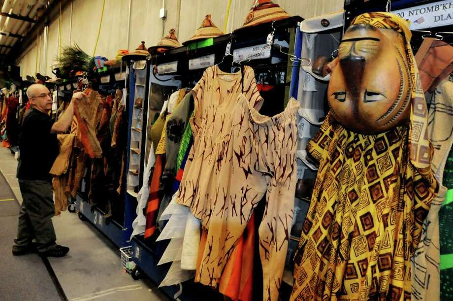 Wardrobe worker Pat Erano hangs up lioness bodysuits in the ?costume bunker? backstage at Proctors. Each rolling closet holds costumes and shoes for three ensemble members. (Cindy Schultz / Times Union) Photo: Cindy Schultz