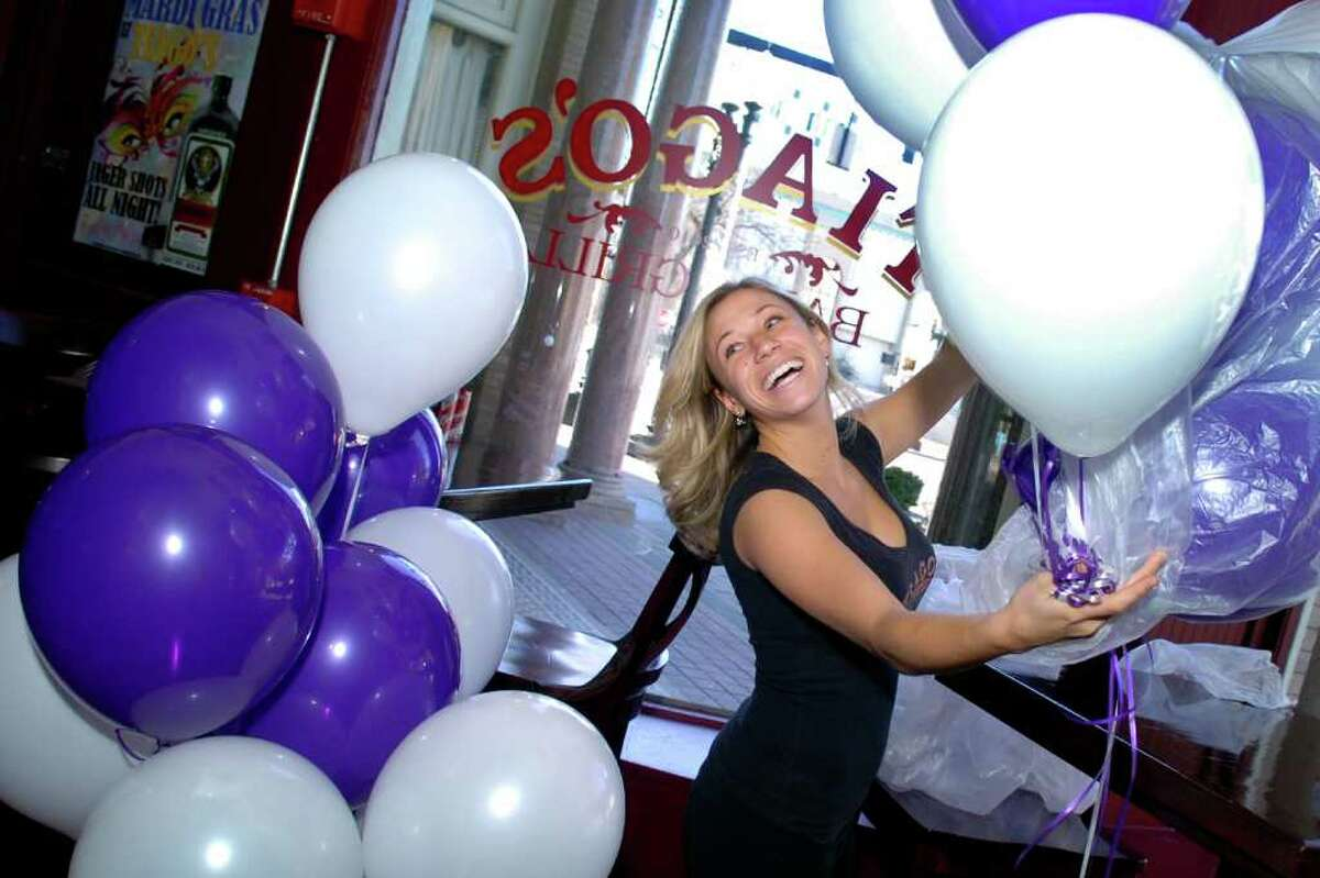 Samantha Mauro prepares balloons as she decorates Tiago's Bar and Grill in downtown Bridgeport, Conn.