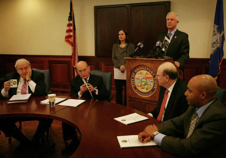 Bridgeport Mayor Bill Finch announces the release of his Election Review Advisory Commission's final report in a press conference at Bridgeport City Hall Annex on Thursday, March 3, 2011. From left are former Bridgeport Mayor Nicholas Panuzio, Attorney Richard Bieder, Secretary of State Denise Merrill, Finch, former Bridgeport Hospital CEO Robert Trefry, and attorney Edwin Farrow. Photo: Brian A. Pounds / Connecticut Post