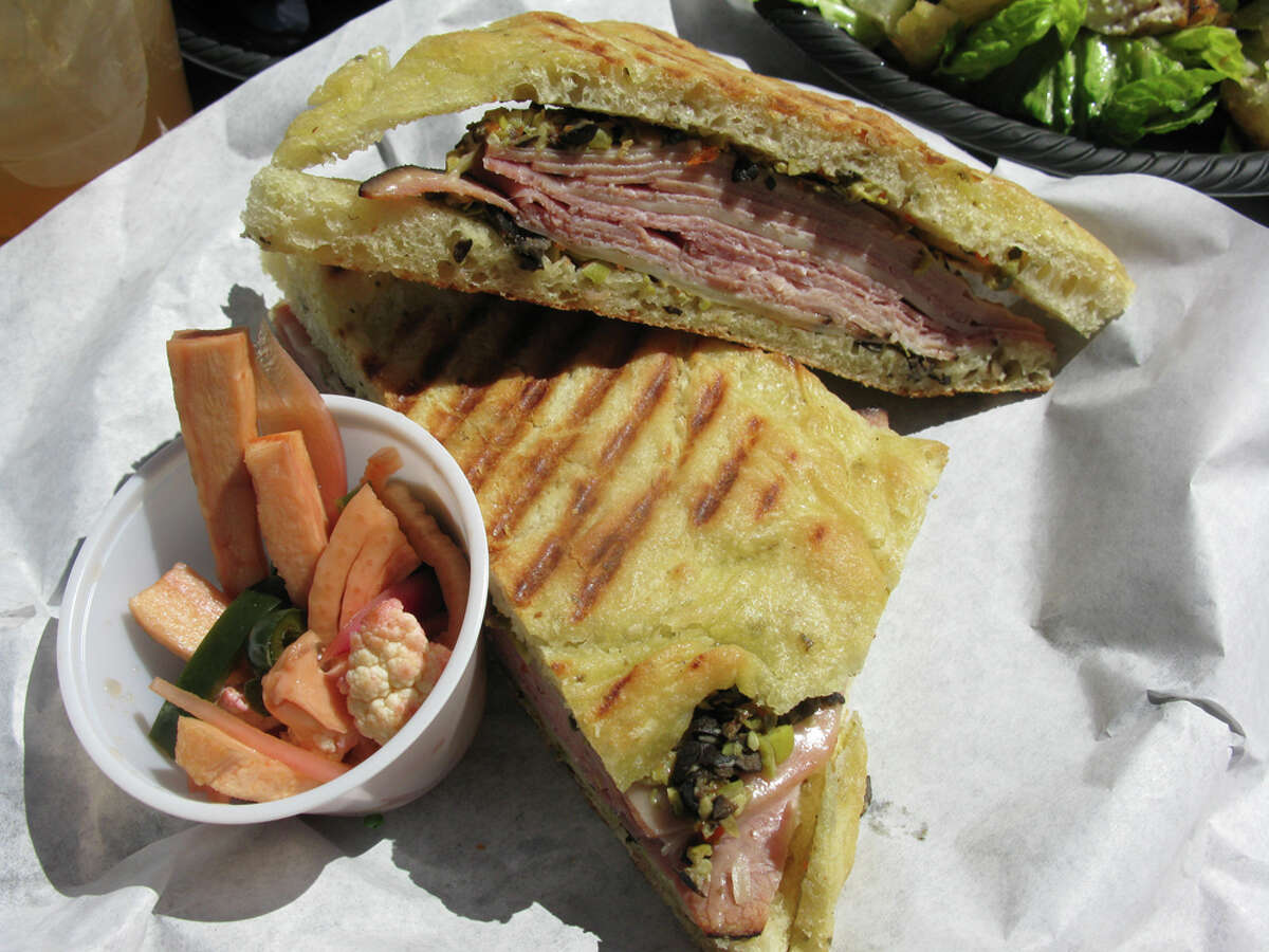 The muffuletta sandwich on focaccia bread from the CIA Bakery Cade is served with pickled vegetables.