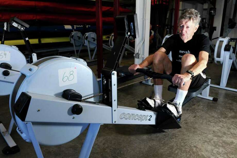 Paul Green works out on a rowing machine at the Saugatuck Rowing Club in Westport, Conn. Feb. 22nd, 2011. Green has Parkinson's Disease, and works out every day. He founded Nevah Surrendah to Parkinson's. Photo: Ned Gerard / Connecticut Post