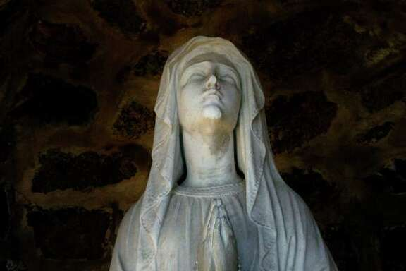A Virgin Mary statue outside St. Benedict - Our Lady of Montserrat Church in the Cove section of Stamford, Conn. on Thursday March 3, 2011.