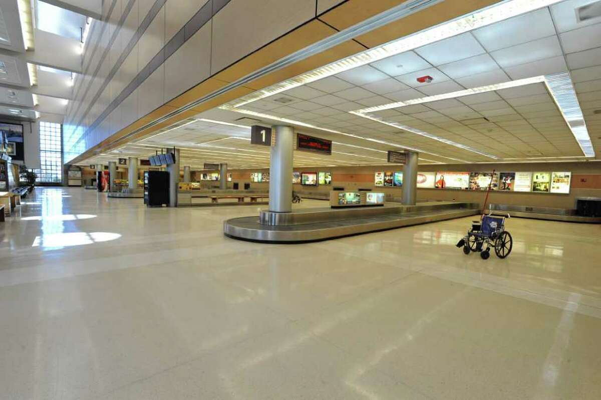 The baggage claim area of the Albany International Airport in Colonie, NY was evacuated in the afternoon on Thursday, March 3, 2011. A cracked battery, in the back up supplies for the airport phone system, caused fumes and was cause for an evacuation on the baggage claim area. (Lori Van Buren / Times Union)
