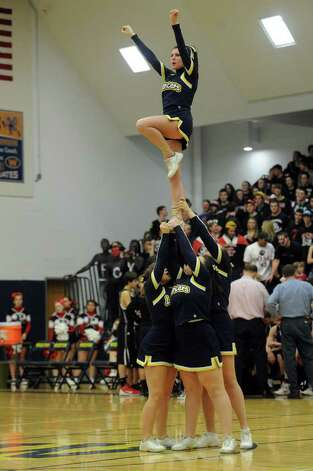 Notre Dame cheerleaders support their team during Thursday's SWC boys basketball final at Weston High School on March 3, 2011. Photo: Lindsay Niegelberg / Connecticut Post