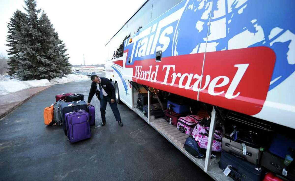 Robert Ayers of Yankee Trails loads luggage for cruise participants at the assembly point in East Greenbush February 18, 2011. (Skip Dickstein / Times Union)