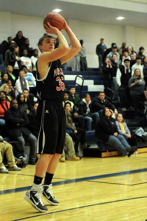 Pomperaug's Tim Harris takes a shot during Thursday's SWC boys basketball final at Weston High School on March 3, 2011. Photo: Lindsay Niegelberg / Connecticut Post