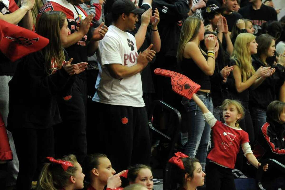 Pomperaug fans cheer for their team during Thursday's SWC boys basketball final at Weston High School on March 3, 2011.
