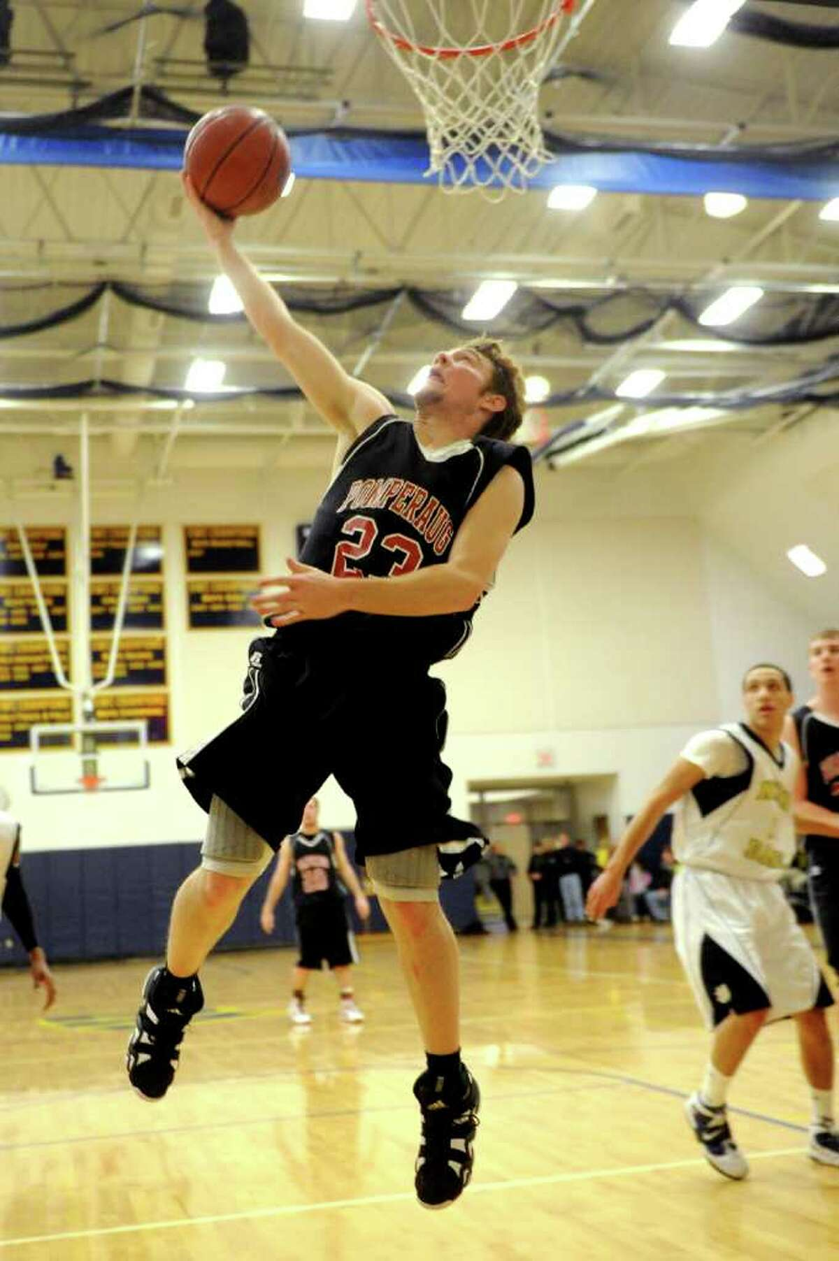 Pomperaug's Brent Pelella takes a shot during Thursday's SWC boys basketball final at Weston High School on March 3, 2011.