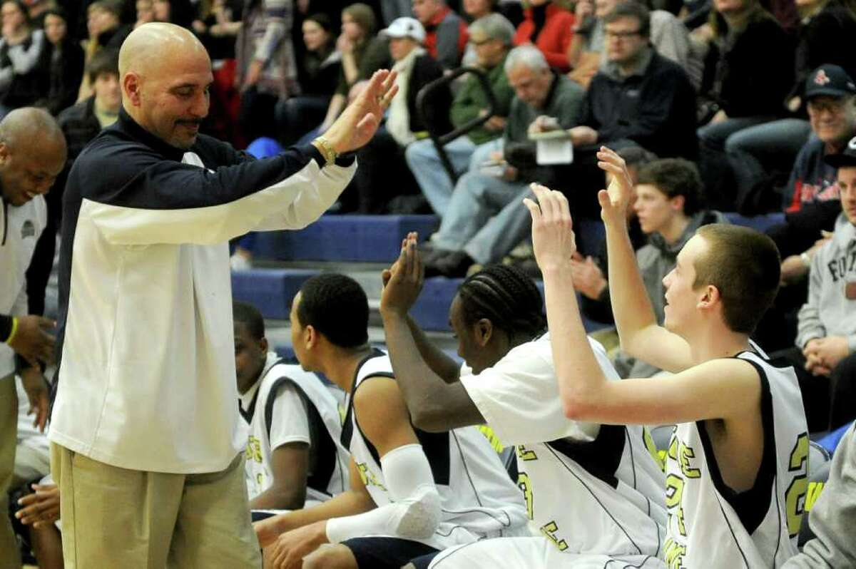 Notre Dame coach Vin Laczkoski high-fives players after his team won Thursday's SWC boys basketball final at Weston High School on March 3, 2011.