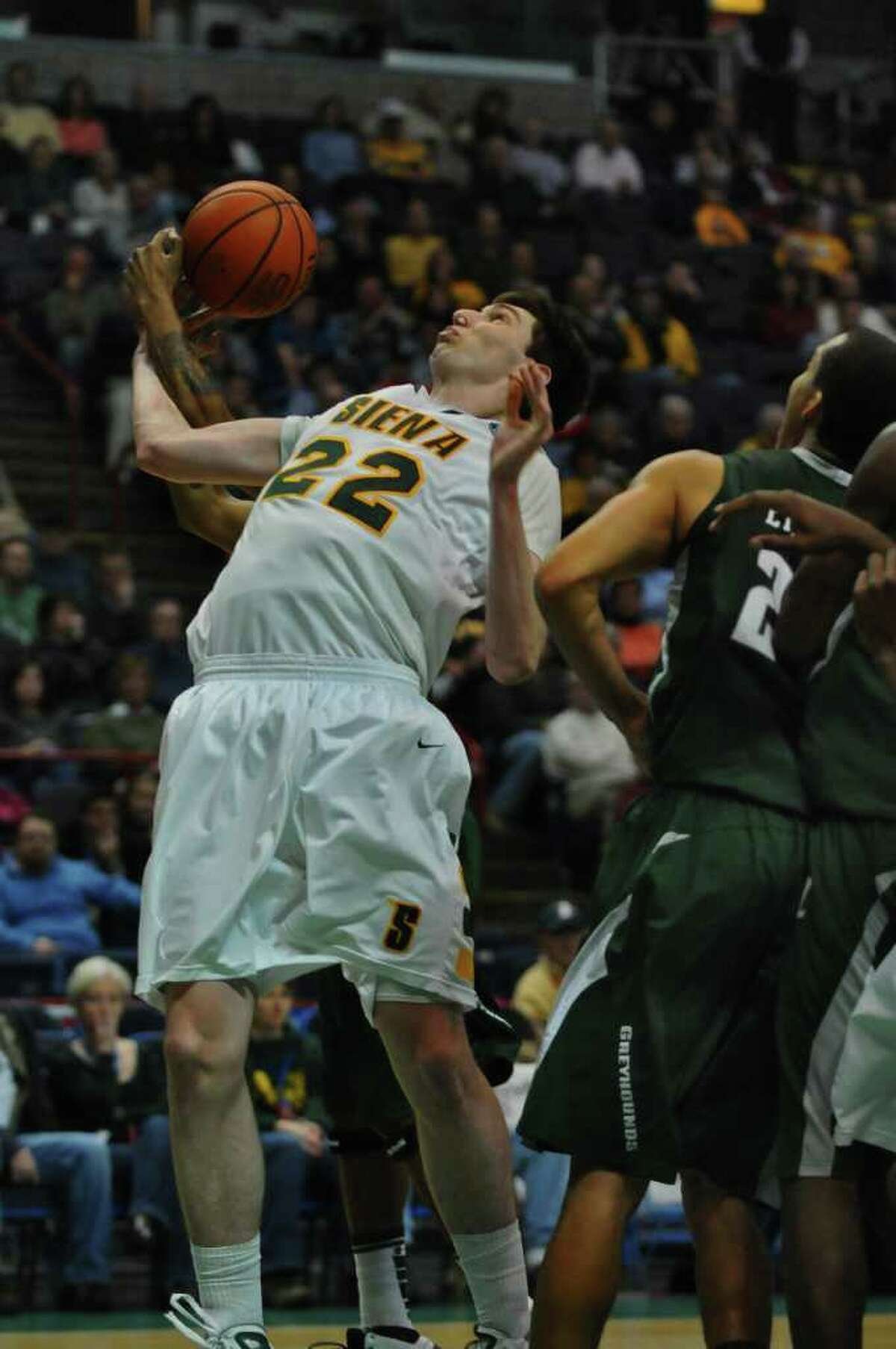Siena's Ryan Rossiter battles for the ball during the second half of their 76-69 loss to Loyola at the Times Union Center in Albany, NY on Monday February 7, 2011. ( Philip Kamrass / Times Union )