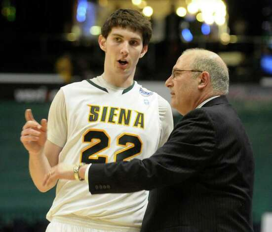 Siena's head coach Mitch Buonaguro talks with Ryan Rossiter during a time out against Marist's during their  Metro Atlantic Athletic Conference basketball game at the Times Union Center in Albany,N.Y., Sunday, Feb. 27, 2011. (Hans Pennink / Special to the Times Union) College Sports Photo: Hans Pennink / 00011629G