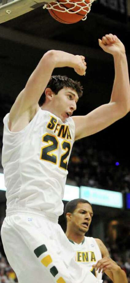 No. 22, Siena's Ryan Rossiter, slams home a dunk in College Basketball vs. Butler at The Times Union Center, in Albany, NY, on Tuesday, Nov. 23, 2010.  Siena lost.  Photos for Daily Sports Dept. coverage.     (Luanne M. Ferris / Times Union) Photo: Luanne M. Ferris / 00011152A