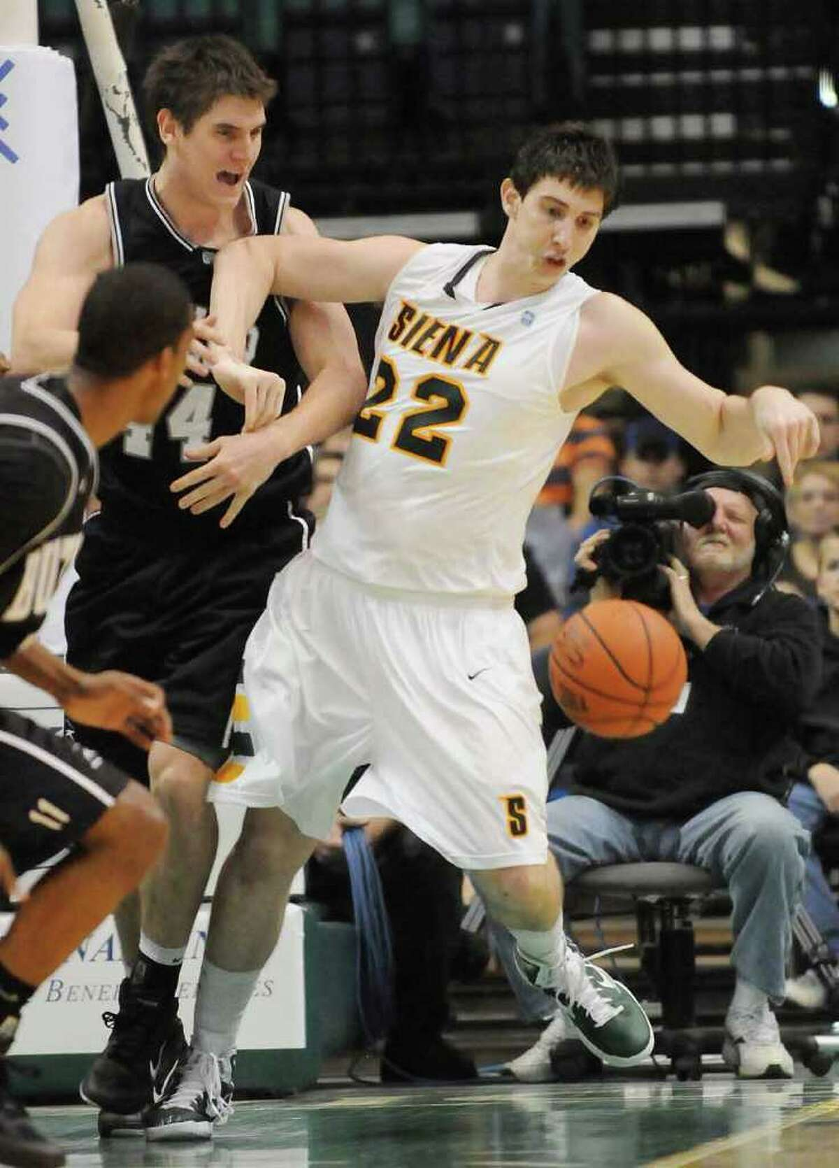 L-R: No. 44, Butler's Andrew Smith, mixes it up under the basket, and tries to muscle No. 22, Siena's Ryan Rossiter, for the loose ball in College Basketball action at The Times Union Center, in Albany, NY, on Tuesday, Nov. 23, 2010. Siena lost. Photos for Daily Sports Dept. coverage. (Luanne M. Ferris / Times Union)