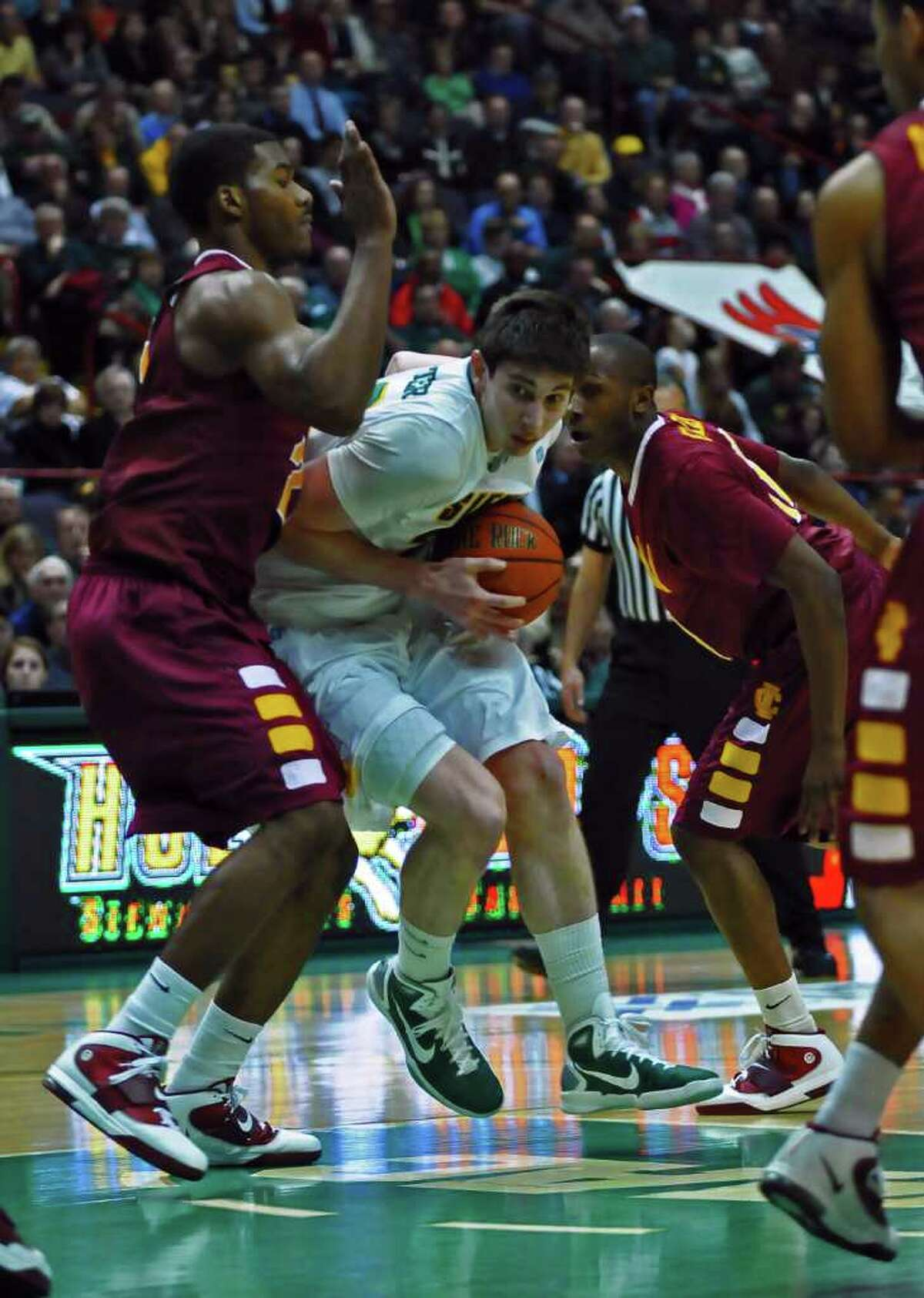 Siena's Ryan Rossiter drives to the basket during Siena's 73-67 victory over Iona at the Times Union Center in Albany, NY on Monday night January 3, 2011. ( Philip Kamrass / Times Union )