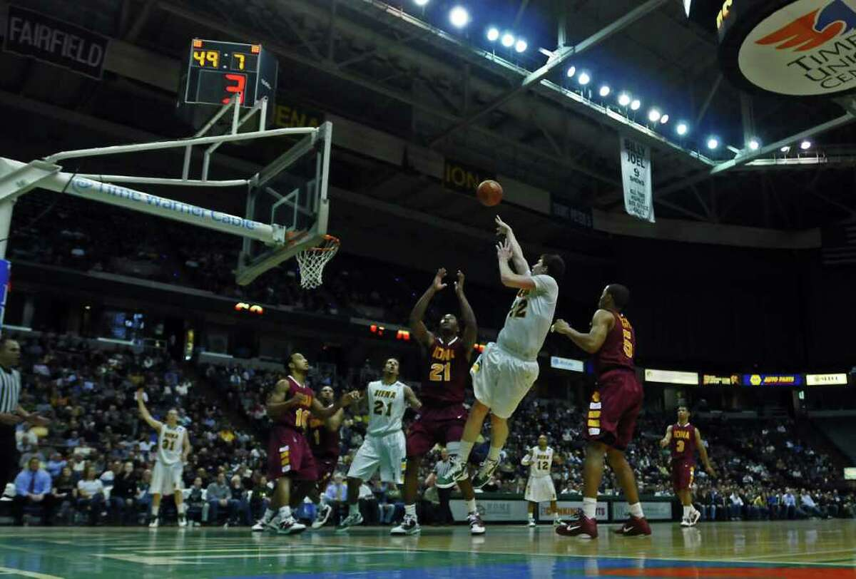 Siena Ryan Rossiter, right, hits a shot with 49 seconds left in the game during Siena's 73-67 victory over Iona at the Times Union Center in Albany, NY on Monday night January 3, 2011. He also sank a foul shot afterwards.( Philip Kamrass / Times Union )