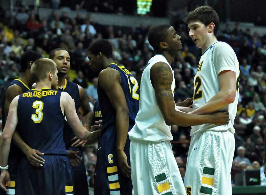 Siena's Clarence Jackson, left, and Ryan Rossiter, right, talk  during the second half of Siena's 73-69 win over Canisius at the Times Union Center in Albany, NY on Monday night January 17, 2011.  ( Philip Kamrass / Times Union ) Photo: Philip Kamrass / 00011629A