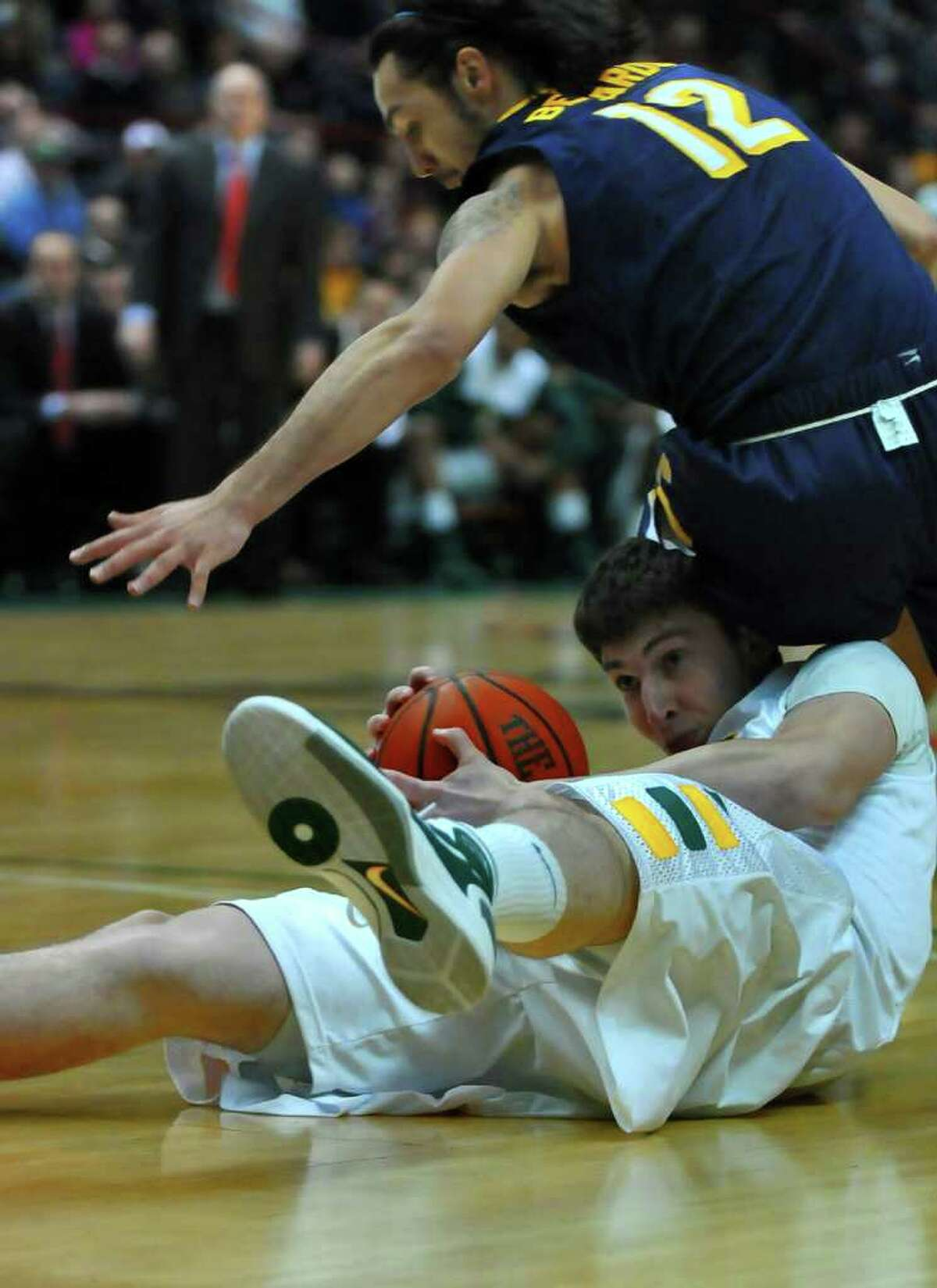 Siena's Ryan Rossiter, bottom, and Canisius Gaby Belardo battle for a loose ball during the first half of Siena's 73-69 win over Canisius at the Times Union Center in Albany, NY on Monday night January 17, 2011. ( Philip Kamrass / Times Union )