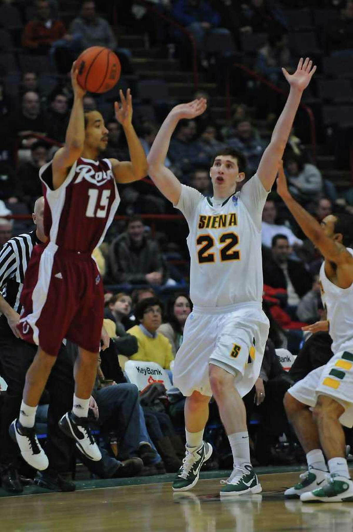 Siena's Ryan Rossiter, 22, defends Rider's Justin Robinson near the end of the second half of Siena's 68-60 loss to Rider at the Times Union Center in Albany, NY, on Monday January 24, 2011. ( Philip Kamrass / Times Union )