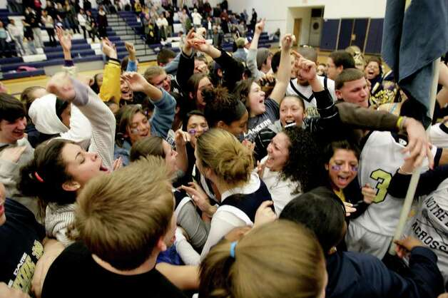Students and fans cheer Pomperaug High School and Notre Dame Catholic High School during the SWC high school men's basketball championship at Weston High School in Weston, Conn. on March 3, 2011. Photo: Peter Caty, Peter Caty/Hearst Media Group / Connecticut Post