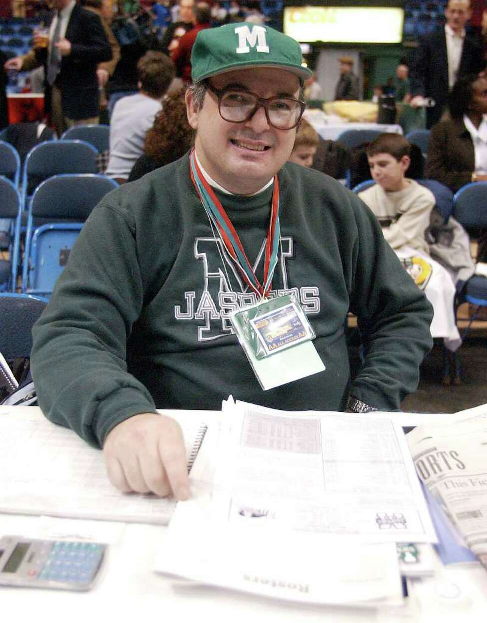 Ronald Weintraub is Manhattan College's most devoted basketball fan. Here, Ronnie sits in press row at the Siena vs Manhattan basketball game in the Pepsi Arena on Jan. 3, 2004. (Times Union Archive)