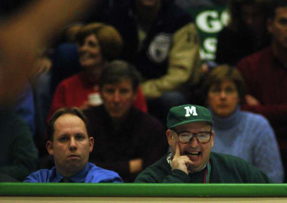 Ronald Weintraub reacts to a play from his seat on press row courtside at the Draddy Gymnasium during the Manhattan College victory over Siena 79-62 at the Riverdale campus Sunday, Feb. 15, 2004. Weintraub, who is mentally challenged, attends nearly every men's basketball game, takes statistics, and may be Manhattan's biggest fan. (Philip Kamrass / Times Union)