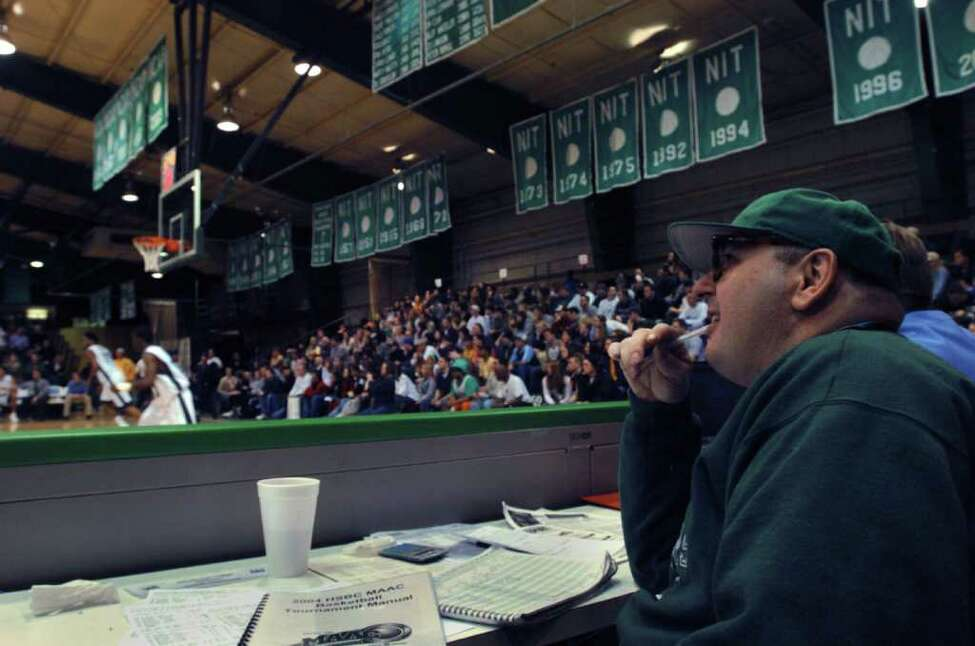 Ronald Weintraub watches from his regular seat on press row courtside at the Draddy Gymnasium during the Manhattan College victory over Siena 79-62 at the Riverdale campus Sunday, Feb. 15, 2004. (Philip Kamrass / Times Union)