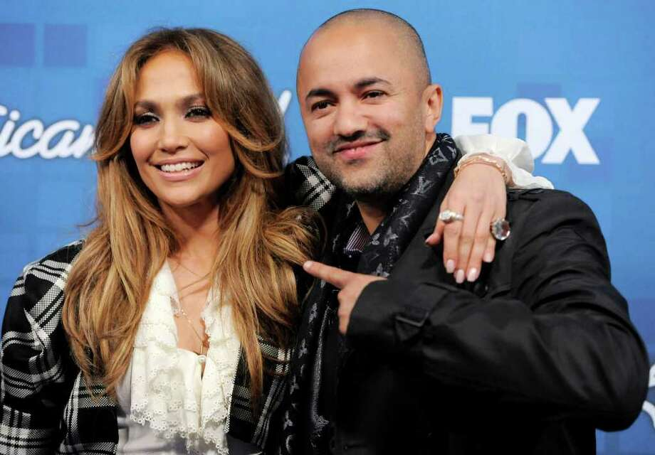 """American Idol"" judge Jennifer Lopez, left, and music producer/songwriter RedOne pose together at the ""American Idol"" Finalists Party in Los Angeles, Thursday, March 3, 2011. Photo: AP"