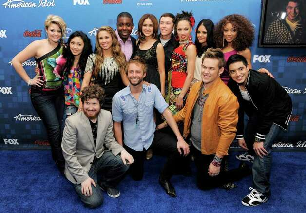 """American Idol"" finalists pose together at the ""American Idol"" Finalists Party in Los Angeles, Thursday, March 3, 2011. In the front row from left to right are Casey Abrams, Paul McDonald, James Durbin and Stefano Langone. In the back row from left to right are Lauren Alaina, Thia Megia, Haley Reinhart, Jacob Lusk, Karen Rodriguez, Scotty McCreery, Naima Adedapo, Pia Toscano and Ashthon Jones. Photo: AP"