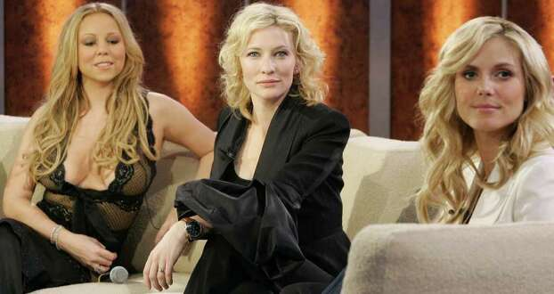 Actress Cate Blanchett, center, sits beside U.S. singer Mariah Carey left, during the German television show 'Wetten Dass...?' ('Bet it...?') in Berlin Saturday March 19, 2005 while German model Heidi Klum right looks on. . Photo: ARND WIEGMANN, AP / POOL REUTERS