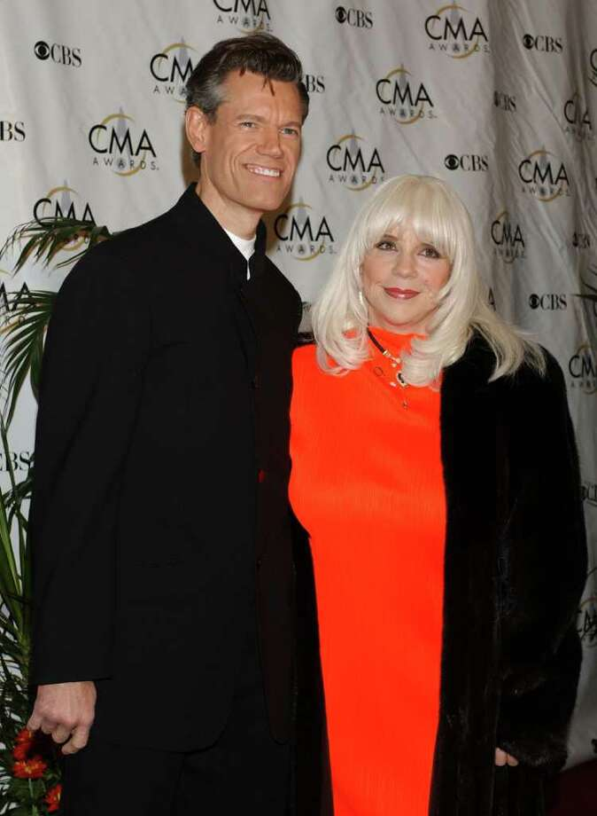 **FILE**Randy Travis and wife Elizabeth Hatcher arrive at The 38th Annual CMA Awards at the Grand Ole Opry on November 9, 2004 in Nashville, Tennessee. Travis and his wife will serve on a newly established New Mexico Music Commission, designed to promote and showcase the state's music industry. Photo: TAMMIE ARROYO, AP / ARROYO