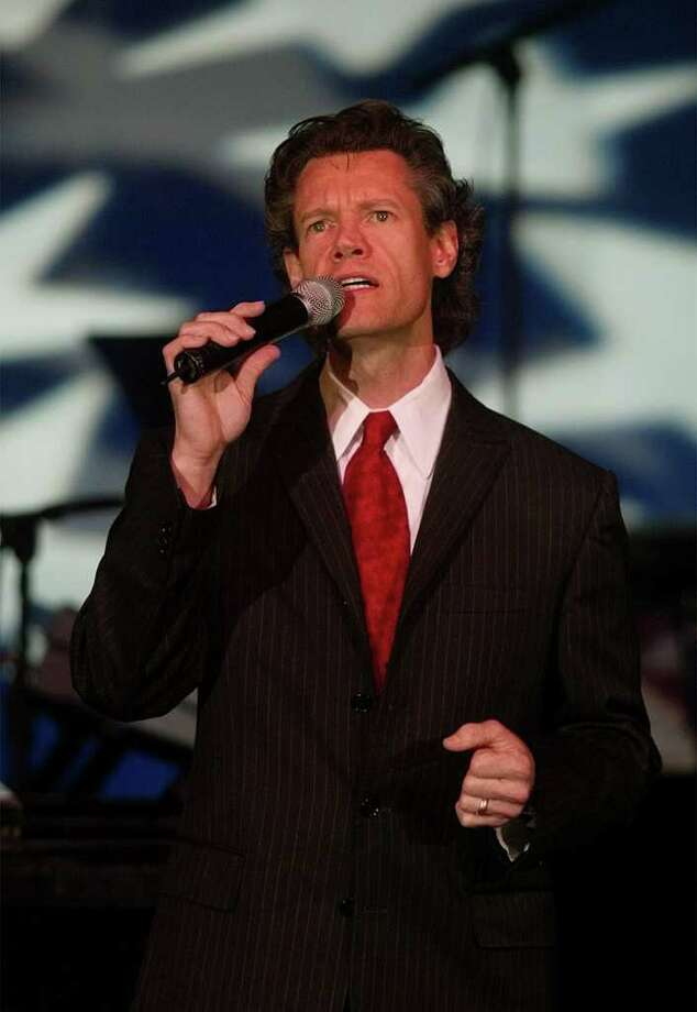 Country music star Randy Travis performs for more than 1,000 family members of the lost and wounded and military personnel from the Pentagon who attended Washington Honors America's Heroes of Freedom concert at Constitution Hall, Wednesday, Sept. 11, 2002. Photo: PABLO MARTINEZ MONSIVAIS, AP / AP