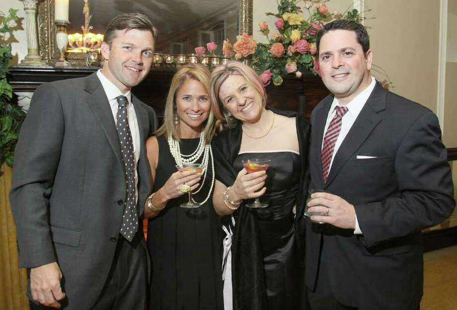 Saratoga Springs, NY - February 26, 2010 - (Photo by Joe Putrock/Special to the Times Union) - (l to r)Brian and Hilary Munson, and Beth and Tim Howe during the SPAC Junior Committee's Winter Ball, a Mad Men themed event. Photo: Joe Putrock / Joe Putrock