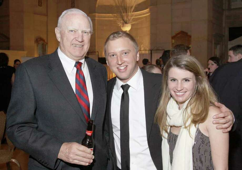 Saratoga Springs, NY - February 26, 2010 - (PHoto by Joe Putrock/Special to the Times Union) - (l tor) Stewart's Shops' Board Chairman William Dake, SPAC Junior Committee Member Jeff Meyer and Katharine Gould during the SPAC Junior Committee's Winter Ball, a Mad Men themed event. Photo: Joe Putrock / Joe Putrock