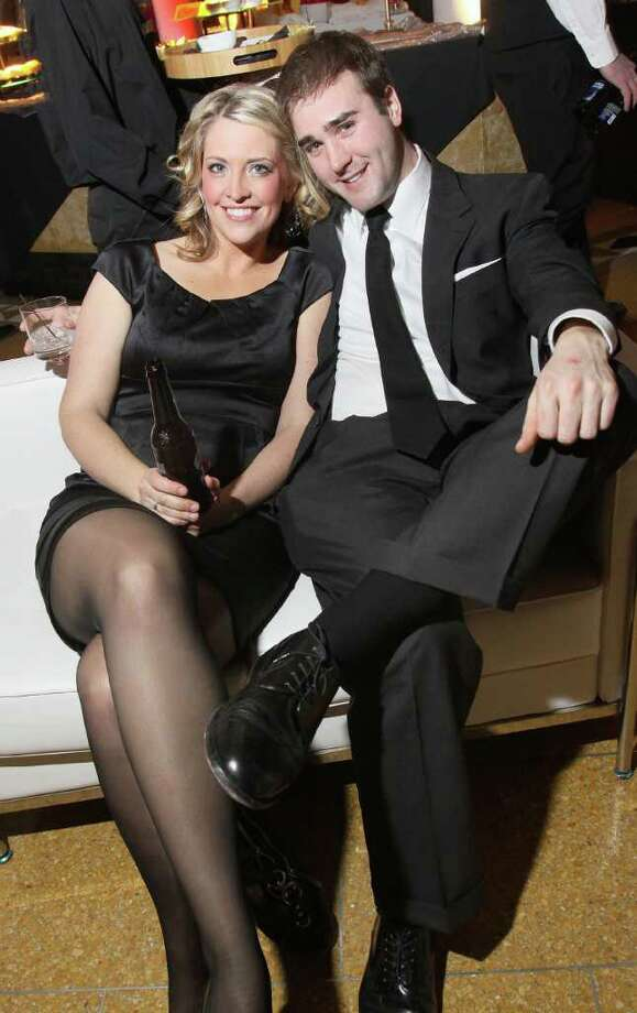 Saratoga Springs, NY - February 26, 2010 - (Photo by Joe Putrock/Special to the Times Union) - Cathleen Hart(left) and Joe Rossi(right) relax on some of the retro furniture during the SPAC Junior Committee's Winter Ball, a Mad Men themed event. Photo: Joe Putrock / Joe Putrock