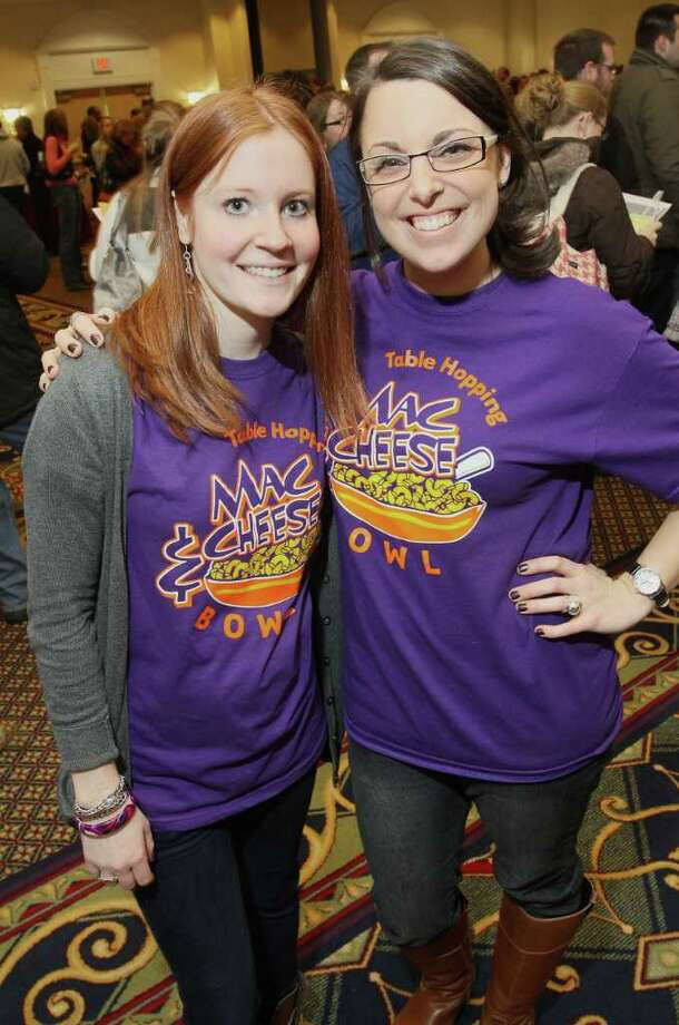 Bethany Stiles, left, and Jessica Tanner who normally work in the Regional Food Bank's Development Department, volunteered during the Table Hopping/timesunion.com Mac-N-Cheese Bowl to benefit the Regional Food Bank.  (Photo by Joe Putrock / Special to the Times Union) Photo: Joe Putrock / JP