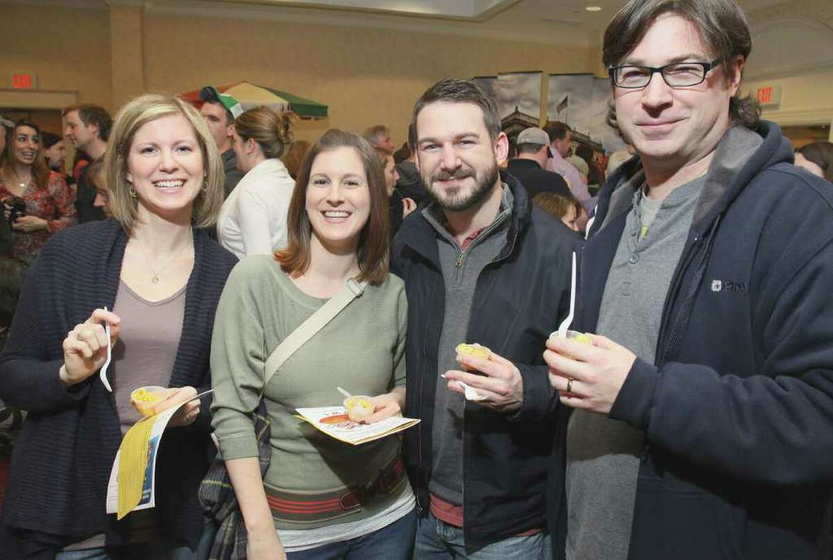From left: Marcy Pendergast, Kara Lacy, Brendan Pendergast and Tim Pendergast sample The Standard's wares during the Table Hopping/timesunion.com Mac-n-Cheese Bowl on Feb. 19, 2011, in Albany, N.Y. (Photo by Joe Putrock / Special to the Times Union)