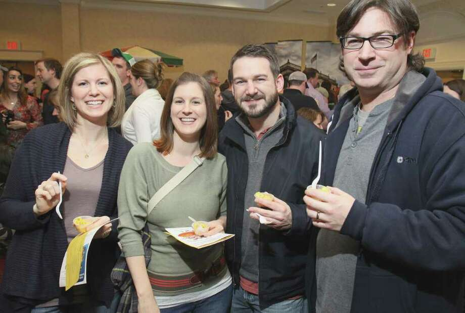 From left: Marcy Pendergast, Kara Lacy, Brendan Pendergast and Tim Pendergast sample The Standard's wares during the Table Hopping/timesunion.com Mac-n-Cheese Bowl on Feb. 19, 2011, in Albany, N.Y.  (Photo by Joe Putrock / Special to the Times Union) Photo: Joe Putrock / JP