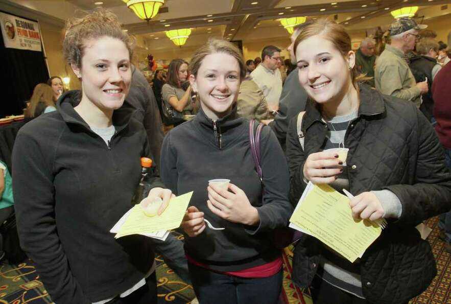 From left: Nora Boyle, Kara Afflitto and Lisa Pagliaro try the mac-n-cheese from the Valente's booth