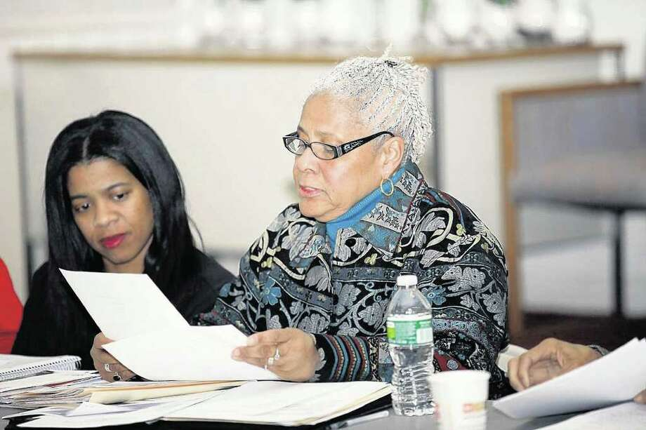 Norwalk NAACP Vice President Sherley Mosby and newly elected President Anita B. Schmidt go over their agenda on Tuesday March 1, 2010 at the Calvary Basptist Church in Norwalk, CT. Photo: Francesca Andre