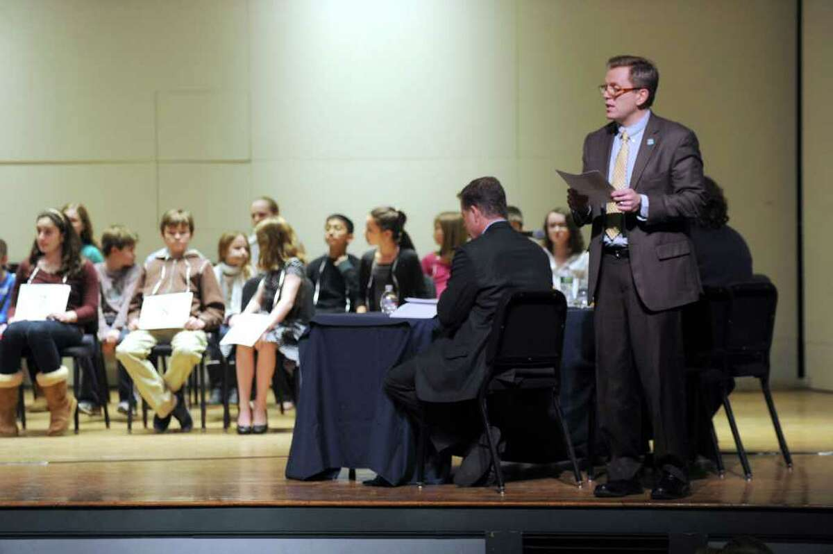 Mark Peczuh, the pronouncer at Thursday nights Hearst Media Services Regional Spelling Bee, calls the participants names as they take the stage at the start of the bee. Photo taken Thursday, March 3, 3011