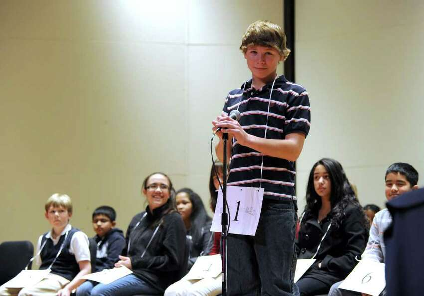 Adam Zukoski, of Ridgefield listens to the word during his practice round at the Hearst Media Services Regional Spelling Bee Thursday night, March 3, 2011.