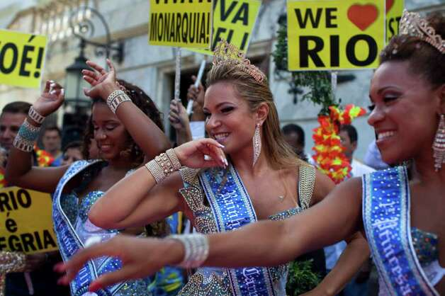 Carnival queen and princesses dance during a ceremony officially opening Carnival season in Rio de Janeiro, Brazil, Friday, March 4, 2011. (AP Photo/Rodrigo Abd) Photo: Rodrigo Abd