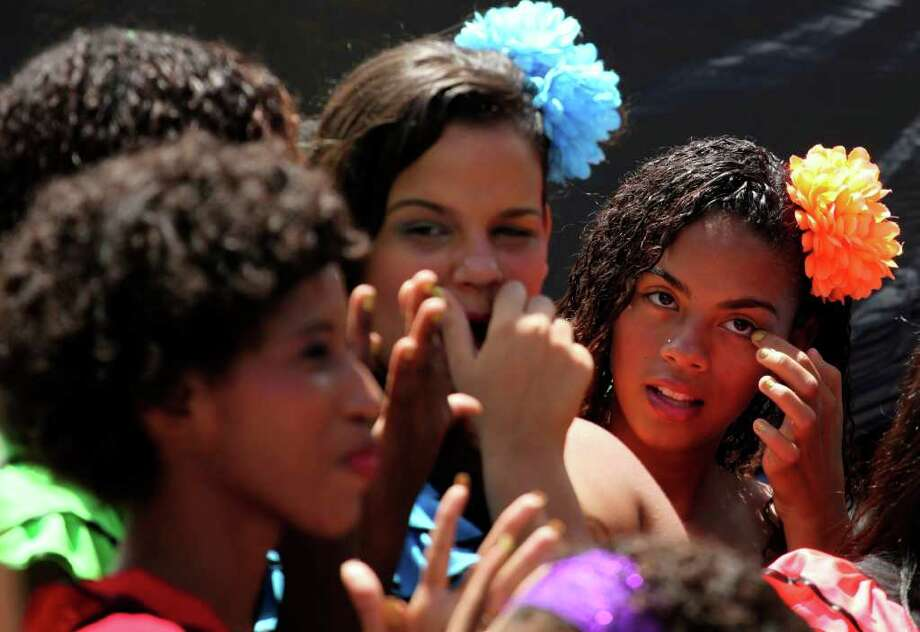 Dancers prepare to dance at the Sambadrome in Rio de Janeiro, Brazil, Friday, March 4, 2011. Brazil will celebrate carnival from March 4 to March 8. (AP Photo/Silvia Izquierdo) Photo: Silvia Izquierdo