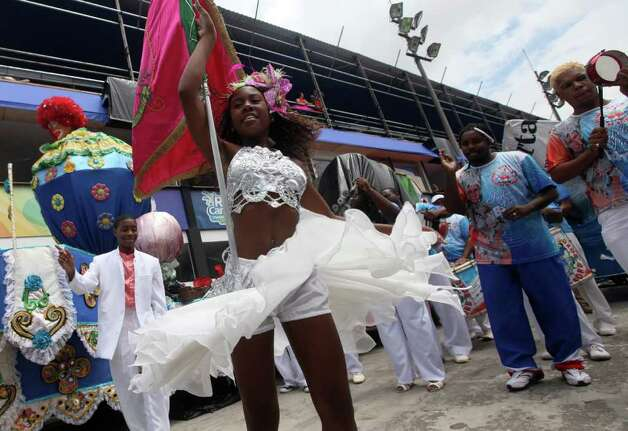 People dance samba at the Sambadrome in Rio de Janeiro, Brazil, Friday, March 4, 2011. Brazil will celebrate carnival from March 4 to March 8. (AP Photo/ Silvia Izquierdo) Photo: Silvia Izquierdo