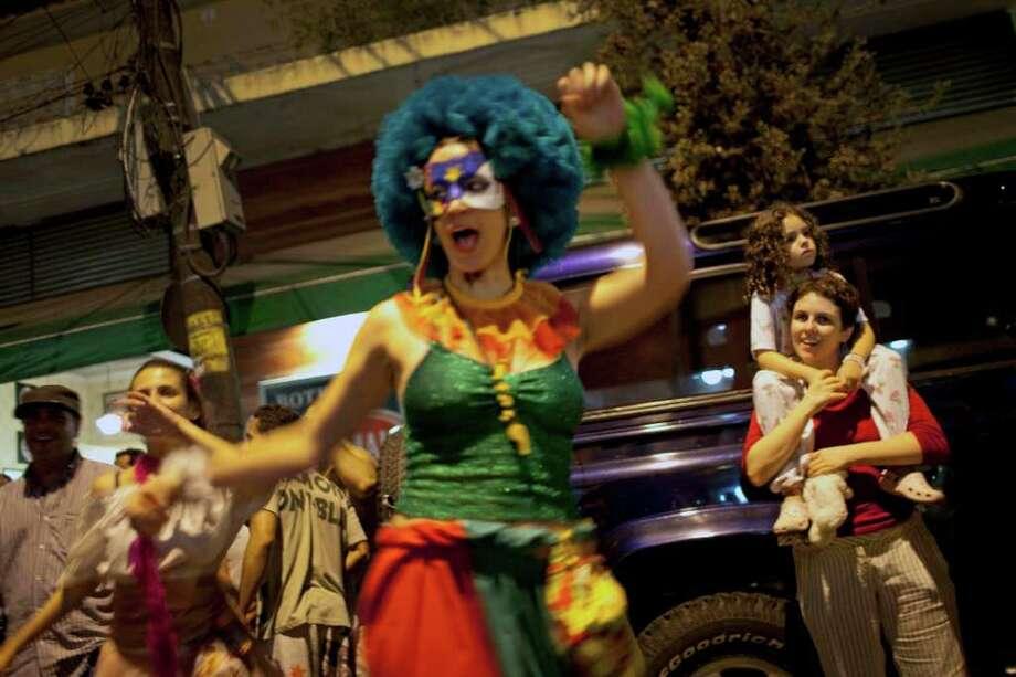 A reveler performs during the 'Mameludicos Euforicos'  street carnival parade in Rio de Janeiro, Brazil, Thursday, March 3,  2011.  (AP Photo/Rodrigo Abd) Photo: Rodrigo Abd