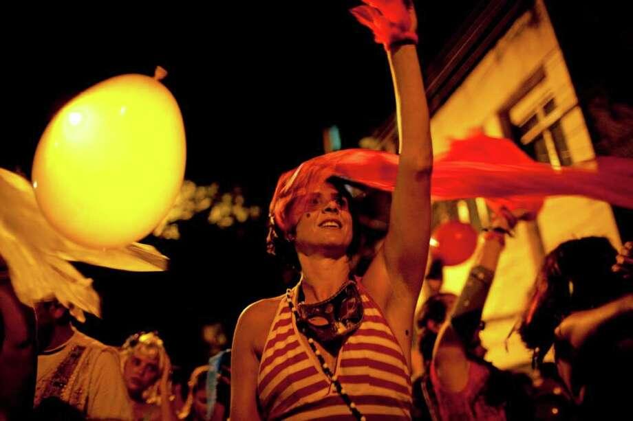 Revelers perform during the 'Mameludicos Euforicos' street carnival parade in Rio de Janeiro, Brazil, Thursday, March 3, 2011. (AP Photo/Rodrigo Abd) Photo: Rodrigo Abd
