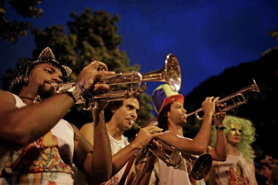 A music band plays at the 'Virtual' street carnival parade in Rio de Janeiro, Brazil, Thursday, March 3, 2011. (AP Photo/Felipe Dana) Photo: Felipe Dana