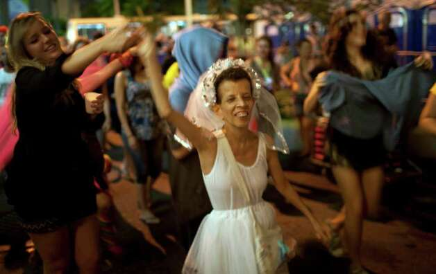 A reveler performs during the 'Mameludicos Euforicos' street carnival parade in Rio de Janeiro, Brazil, Thursday, March 3, 2011. (AP Photo/Rodrigo Abd) Photo: Rodrigo Abd