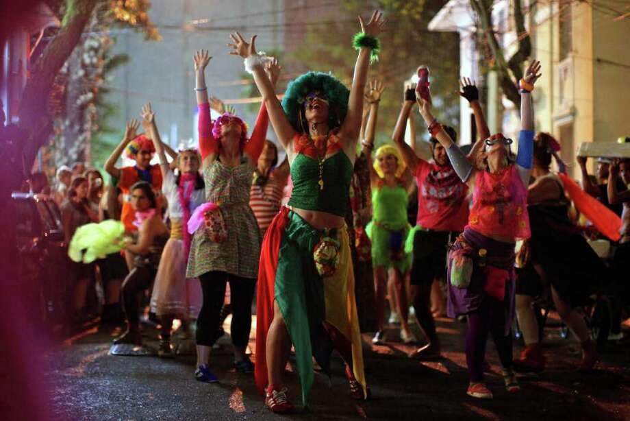 Revelers perform during the 'Mameludicos Euforicos' street carnival parade in Rio de Janeiro, Brazil, Thursday, March 3, 2011. (AP Photo/Felipe Dana) Photo: Felipe Dana