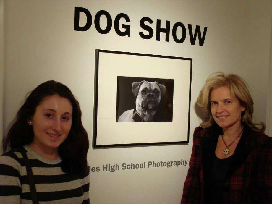 Helen Klisser During, director of visual arts for the Westport Arts Center, right, and Callie Loparo, 16, a Staples High School student and member of the school's Photography CLub, stand before a photograph in an exhibit titled Dog Show at the arts center, which focuses on the plight of shelter dogs. Photo: Contributed Photo / Westport News contributed